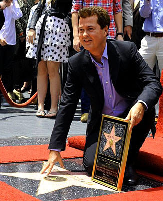 "British entertainment entrepreneur Simon Fuller's new kids' show ""The Meeps"" debuts Wednesday. Above, Fuller receives his star on the Hollywood Walk of Fame in 2011."