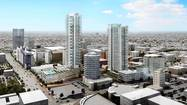 The developer of a skyscraper project in the heart of Hollywood agreed Tuesday to reduce the height of two residential towers that have generated heated opposition, but residents say the roughly 25% reduction still does not address traffic concerns.