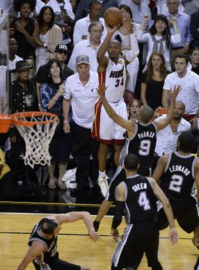 Miami Heat guard Ray Allen (34) hits a three-point jumper to tie the score and force overtime as San Antonio Spurs point guard Tony Parker (9) during the final seconds of regulation of Game 6 of the NBA Finals.