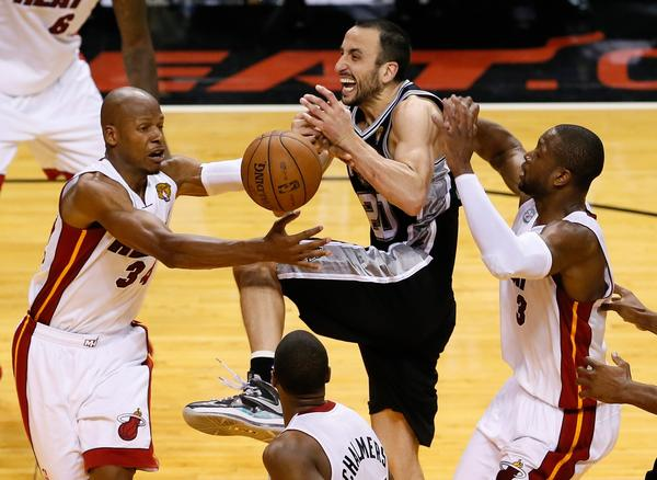 San Antonio Spurs' Manu Ginobili loses the ball between Miami Heat's Ray Allen, left, and Dwyane Wade late in overtime of Game 6.