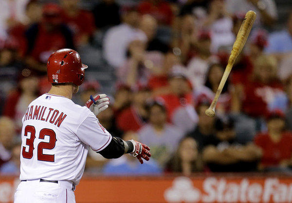 Angels' Josh Hamilton tosses his bat after striking out in the seventh inning of Tuesday's game against the Seattle Mariners.