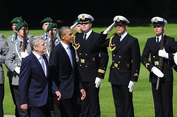President Obama walks with German President Joachim Gauck at the Schloss Bellevue in Berlin.