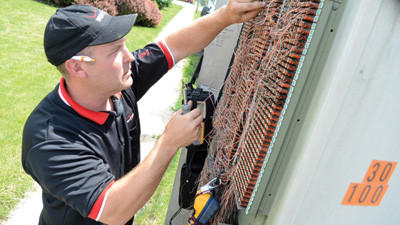 John Troha, a service technician for Verizon, installs high-speed Internet for a New Centerville customer at a cross box near 281 on Monday.
