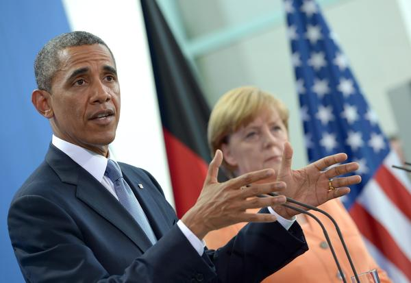 President Obama speaks at a joint news conference with German Chancellor Angela Merkel in Berlin.