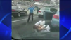 Businessmen fight on L.A. street [Video]