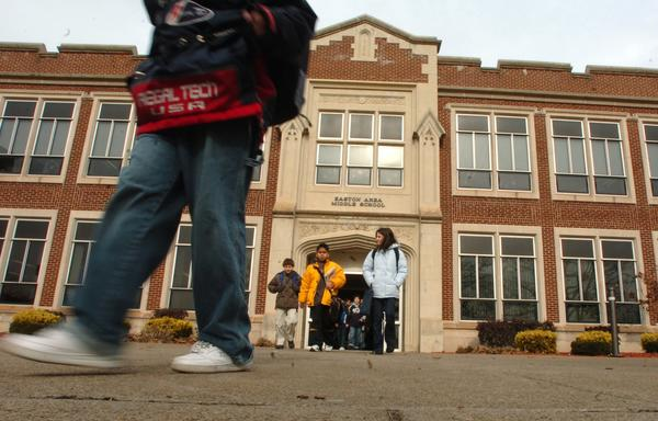 The Easton Area School Board eliminated 43 positions  teachers, coaches, a nurse, janitors  to balance a budget season that also saw a 1.7 percent tax hike.