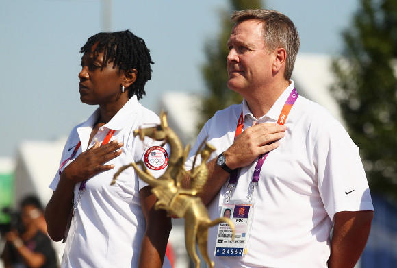 Four-time Olympic basketball champion Teresa Edwards, the U.S. chef de mission, and USOC CEO Scott Blackmun at the Olympic Village welcoming ceremony for the U.S. team (Alexander Hassenstein / Getty Images)