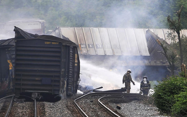 Rosedale, Md--5/28/13--Firefighters at the scene of a cargo train derailment in Rosedale.