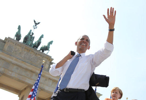 President Obama waves to spectators before he delivers a speech in front of the Brandenburg Gate in Berlin.