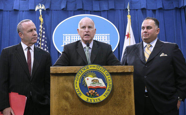 Gov. Jerry Brown reports on the budget compromise with Senate President Pro Tem Darrell Steinberg, left, and Assembly Speaker John Perez.