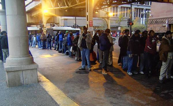 A line of homeless people awaits donations during a Community Ministry event in downtown Chicago this winter.