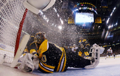 Boston Bruins goalie Tuukka Rask (40) dives for the puck wide of the net during the second period in game three of the 2013 Stanley Cup Final against the Chicago Blackhawks at TD Garden.