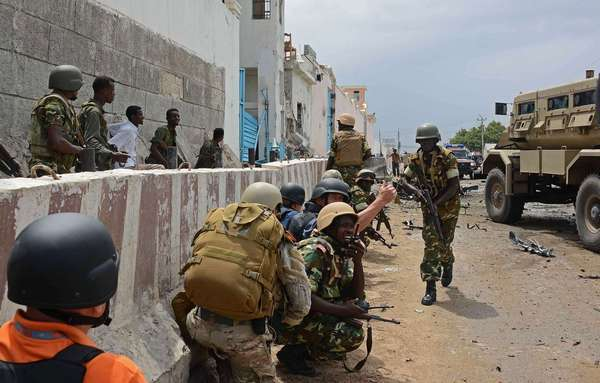 An African Union force in Somalia reacts after Al Qaeda-linked insurgents attacked a United Nations compound in Mogadishu.