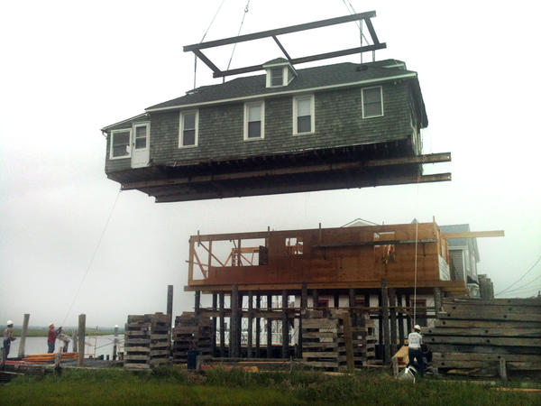 A home in Sea Isle City, N.J., is moved to an adjoining property to correct damage issues inflicted by Superstorm Sandy.