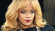 See Rihanna hit a fan with her microphone during concert