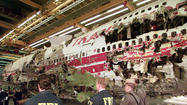 Federal officials are weighing a request to reopen the investigation of the 1996 explosion and crash of TWA Flight 800 that went down off the coast of Long Island, killing all 230 people aboard.