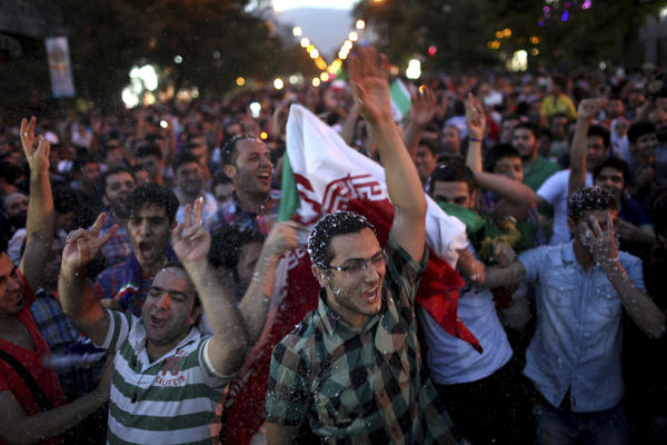 Iranians celebrate in the capital, Tehran, after their national soccer team qualified for the 2014 World Cup.