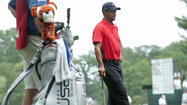Tiger Woods said he has a strained left elbow that will keep him from playing in the AT&T National next week.