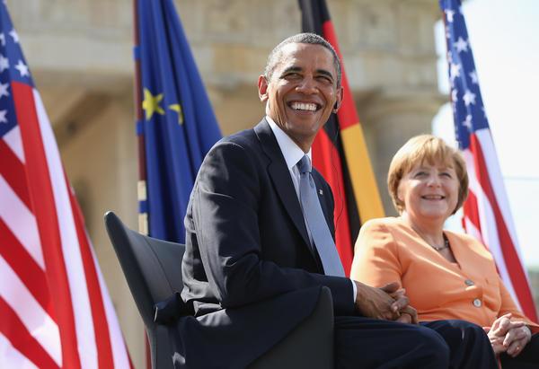 President Obama and German Chancellor Angela Merkel arrive to speak at the Brandenburg Gate in Berlin.
