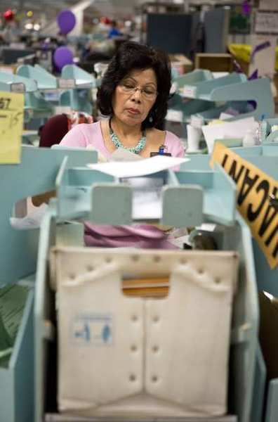 Cora Riegel sorts California tax returns while working at the Franchise Tax Board in Sacramento.