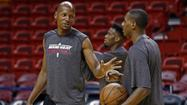 Miami Heat player Ray Allen jokes with his teammate Mario Chalmers during a team practice ahead of Game 7 of the NBA Finals basketball playoff against the San Antonio Spurs in Miami