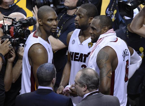 Miami's Big Three of Chris Bosh, left, Dwyane Wade and LeBron James exhale after the Heat's overtime victory over San Antonio in Game 6 of the NBA Finals.