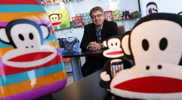 Paul Frank parent company Saban Brands President Elie Dekel surrounded by products featuring Paul Frank icon Julius the Monkey.