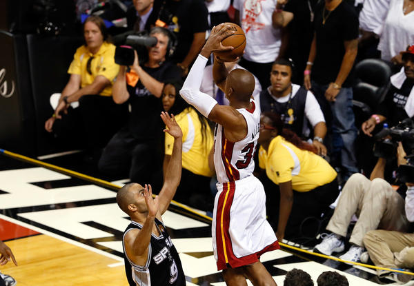 Ray Allen of the Miami Heat makes a game-tying three-pointer over Tony Parker of the San Antonio Spurs in the fourth quarter during Game Six of the 2013 NBA Finals.