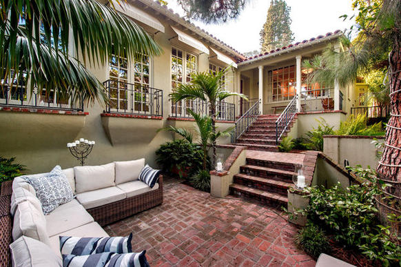 Stairs lead down to an outdoor sunken living room at the back of Jodie Foster's house.