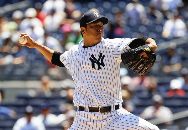 Hiroki Kuroda of the New York Yankees got the win against his former team, the Los Angeles Dodgers, at Yankee Stadium on Wednesday afternoon.