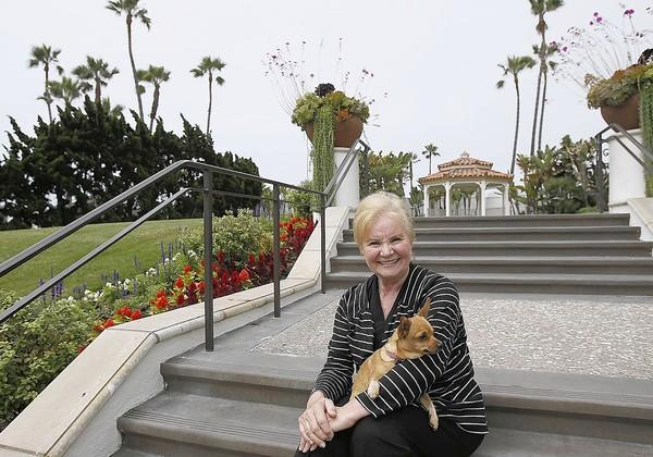 Gisela Campagne, the southern California director of Waggin' Trails Rescue Foundation poses for a photo with her 3-year-old Chihuahua mix, Molly, at the Hilton Waterfront Beach Resort on Thursday, June 13. Campagne is organizing a Wags N' Wine fundraiser for Waggin' Trails Rescue Foundation.