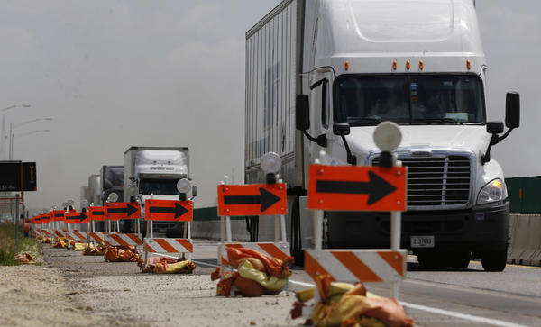 Westbound Interstate 90 lanes on the Jane Addams are down to a single lane near Irene Road in Belvidere on Wednesday.