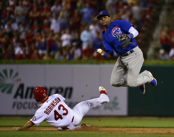 St. Louis Cardinals pinch runner Shane Robinson interferes with Chicago Cubs shortstop Starlin Castro Tuesday night.