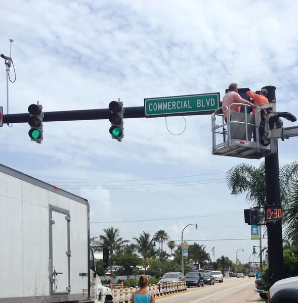 New signals give pedestrians a green light at the intersection of Commerical Boulevard and A1A. The signals will require all drivers to stop in all directions at the same time.