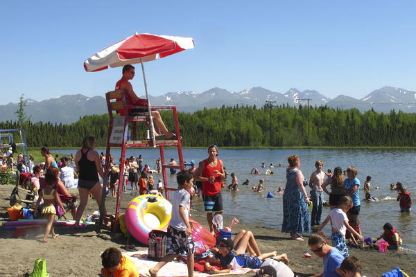 Alaskans enjoy the sun and water at Goose Lake in Anchorage this week.