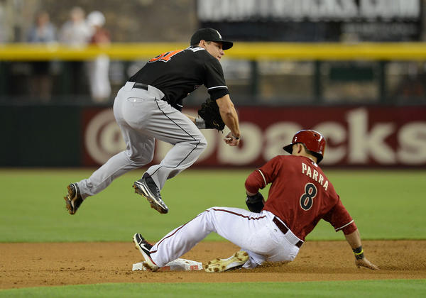 PHOENIX, AZ - JUNE 19: Derek Dietrich #51 of the Miami Marlins turns a double play as Gerardo Parra #8 of the Arizona Diamondbacks slides into second base at Chase Field on June 19, 2013 in Phoenix, Arizona. (Photo by Norm Hall/Getty Images) ORG XMIT: 163494176