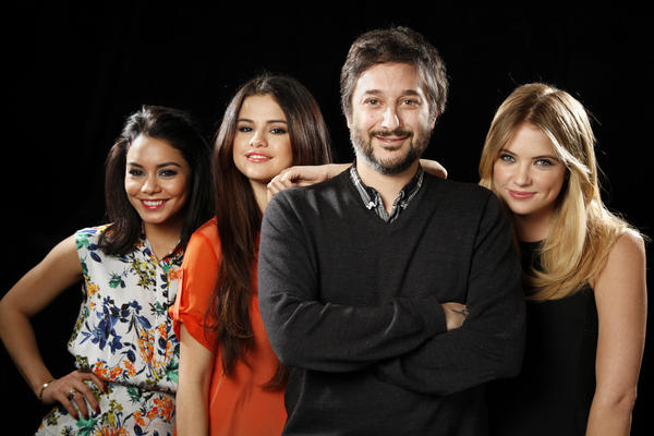 "Director Harmony Korine poses for a portrait with three of his four lead actresses from his new film ""Spring Breakers"": Vanessa Hudgens, left, Selena Gomez and Ashley Benson."