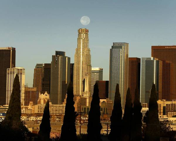 At 72 stories, the circular U.S. Bank Tower, center, has commanded the city skyline since it was completed in 1989.