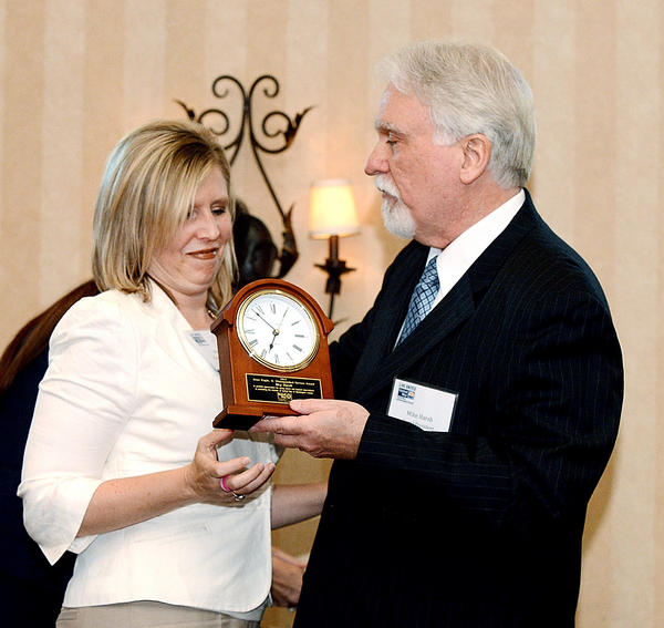 Meg Harsh receives the Jesse L. Kagle Distinquished Service Award from Mike Harsh, president of the local United Way's board of directors at the organization's annual dinner and report to the community held Wednesday at Fountain Head Country Club in Hagerstown.