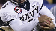 WASHINGTON (Reuters) - Three U.S. Naval Academy football players have been charged with raping a female midshipman and making false statements, the school said on Wednesday, the latest in a string of sexual assault allegations in the U.S. military.