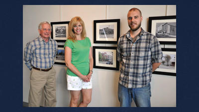 Exhibit organizers Ron Bruner, Jodi Brougher and Jacob Miller stand in front of the new photography exhibit at the Somerset Historical Center. The exhibit was created by the Laurel Highlands Photography Club. It contains photographs that Walter Bowen shot of the area in the 1950s, 60s and 70s. Club members revisited the sites. Their updated photographs provide evidence of how the landscape has changed.