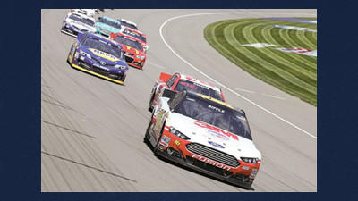 Driver Greg Biffle leads the field through the first turn during the NASCAR Quicken Loans 400 auto race Sunday at Michigan International Speedway. It was a day of celebration for Ford, the Michigan-based company, but there are still a few concerns despite Biffle's victory.