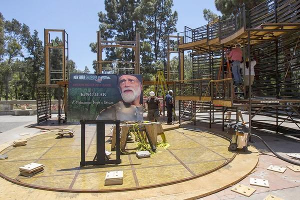 Workers build a Shakespearean-style theater at the Gateway Commons at UCI on Wednesday.
