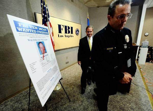 Assistant LAPD Chief Michel Moore, right, and Bill Lewis, FBI assistant director in charge of the Los Angeles office, discuss the arrest of former USC professor Walter Lee Williams.