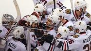BOSTON — Five times the Bruins put the puck past Blackhawks goalie Corey Crawford.