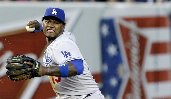 Hanley Ramirez looks to beat out Jayson Nix with a throw to first during the Dodgers' 6-0 victory over the New York Yankees in second game of a doubleheader Wednesday.