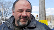 "James Gandolfini, who helped usher in a new golden era of television in his Emmy-winning role as Tony Soprano on HBO's ""The Sopranos,"" died suddenly in Rome of a possible heart attack. He was 51."
