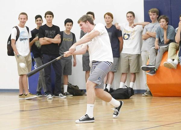 Nolan McCarthy belts a home run in the 13th annual Corona del Mar Whiffle Ball tournament championship, Friday. The tournament has become a favorite for many students created by Gary Almquist, the school's activities director.