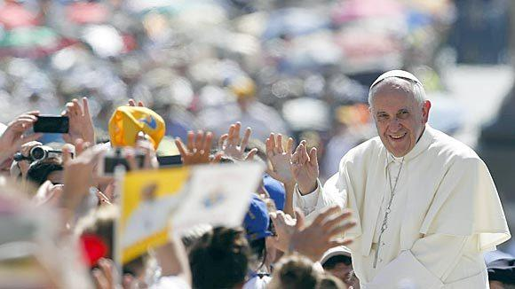 Pope Francis waves as he arrives to lead the weekly audience in Saint Peter's Square at the Vatican June 19.