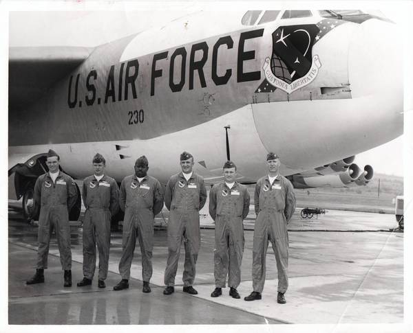 Photos courtesy of Betty Huggins Lt. Col. James W. Huggins, third from left, poses with others after his final flight for the Air Force.